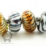 Left to right: lime green tiger tail, TB grey wolf, siberian tiger, TB zebra