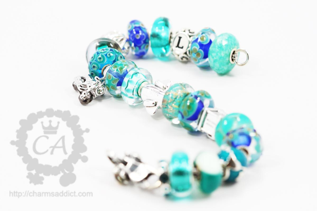 how to put charms on a chamilia bracelet